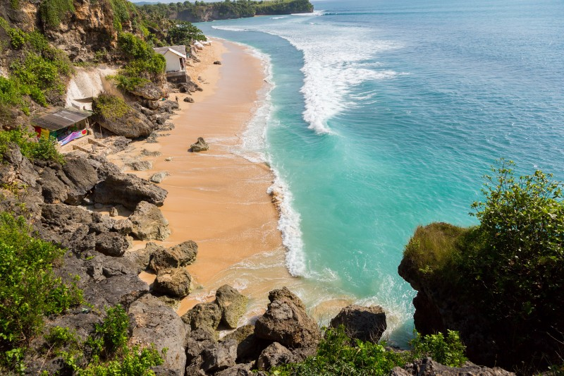 beautiful beach where people are surfing in water